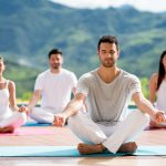 group-of-people-meditating-in-a-yoga-class-815458488-59ee3c56aad52b0010862b83